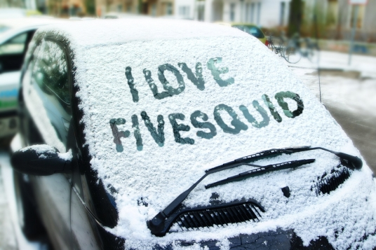 write your text on a snow covered car