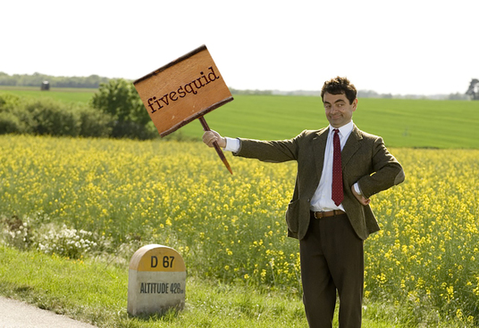 I will make Mr. Bean hold your logo or text engraved on wooden board