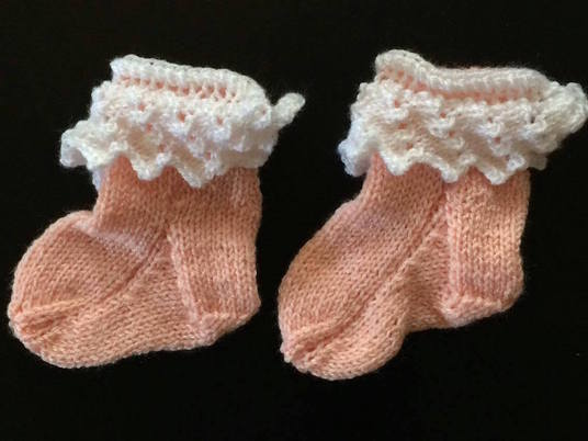 I will knit one pair of adorable frilly baby socks!