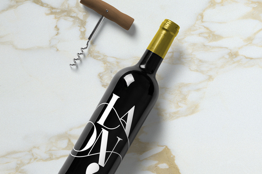 I will create a photorealistic wine bottle mock up of your logo or wine sticker