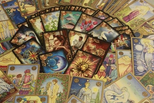 I will give a Tarot card reading