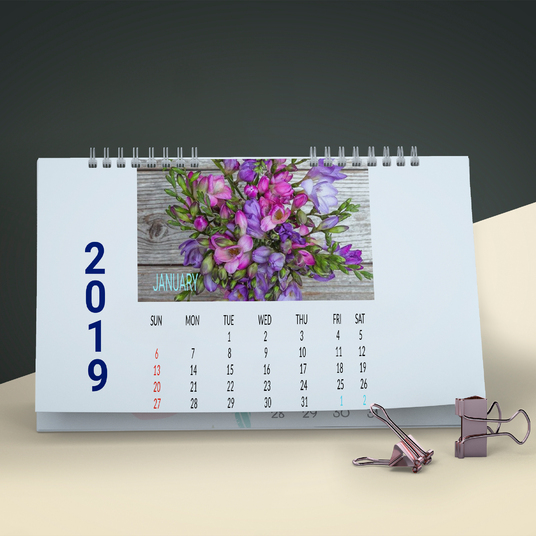 I will do eye catching Wall Calendar OR Desk Calendar