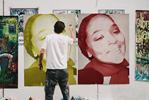 I will let a street artist paint your picture on a poster wall
